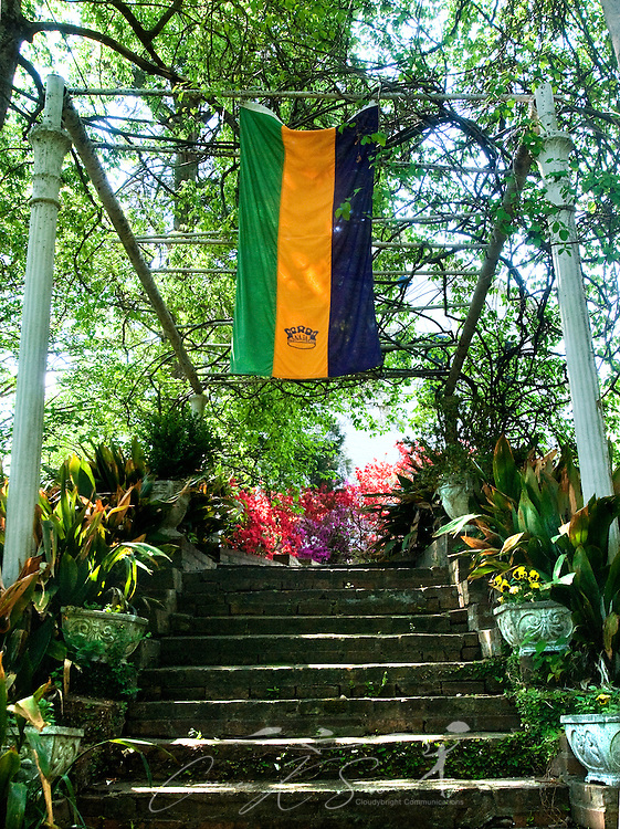 A Mardi Gras flag hangs from an arbor along a shady staircase in the gardens of Rosewood Manor in Columbus, Miss. April 16, 2010. The Greek-Revival antebellum home was among nearly two dozen on tour during Columbus' annual Spring Pilgrimage. (Photo by Carmen K. Sisson/Cloudybright)