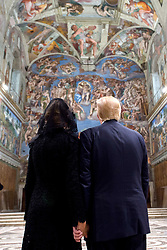 President Donald Trump and his wife Melania look at the frescoed ceilings during their visit to the Sistine Chapel at the Vatican.<br /><br />EDITORIAL USE ONLY. NOT FOR SALE FOR MARKETING OR ADVERTISING CAMPAIGNS.