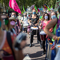 A samba band plays during a large Extinction Rebellion demonstration in London urging the government to take action on climate change.