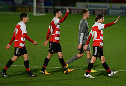 © London News Pictures. 26/02/2014. Doncaster, UK. One Directions Louis Tomlinson (R) makes his debut for Doncaster reserves against Rotherham at the Keepmoat Stadium in Doncaster 26 February 2014 . Photo credit: London News Pictures.