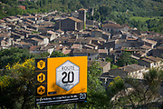 Aerial landscape overlooking the pretty French medieval walled village of Lagrasse (incl the Church of Saint-Michel) on the River Orbieu, on 23rd May, 2017, in Lagrasse, Languedoc-Rousillon, south of France. Lagrasse is listed as one of France's most beautiful villages and lies on the famous Route 20 wine route in the Basses-Corbieres region dating to the 13th century.