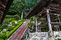 """Konomneji Belltower - Temple 27 Konomineji is situated a long days walk - about 28 kilometers - from the previous temple, Kongochoji.  Konomineji is situated at 424 meters above sea level on the upper slope of Konomine Peak.  A section of the footpath leading to it is very steep, so the temple is called a Nansho Temple, meaning that it is hard to reach. It is one of the most difficult climbs in the entire pilgrimage, the path leading to the temple continues for more than a kilometre at a slope of 45 degrees. It is also classed as asekisho, a kind of """"spiritual checkpoint"""" where your motives are examinedand if found wanting pilgrims would be unable to carry on with the pilgrimage. Konomineji was founded in the early 8thcentury by Gyoki who is credited with founding quite a few of the temples on the Shikoku Pilgrimage, about a century later Kobo Daishi visited and expanded the temple.  On the temple's slopes is a beautifully sculpted vertical garden."""