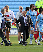 Photo: Mark Stephenson.<br /> Coventry City v Bristol City. Coca Cola Championship. 15/09/2007.Bristol manager Gary Johnson shakes the referee's hane with a dejected Iain Dowie looking on