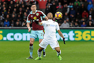 Swansea's Jordan Ayew (3) holds the ball up from Burnley's Stephen Ward. Premier league match, Swansea city v Burnley at the Liberty Stadium in Swansea, South Wales on Saturday 4th March 2017.<br /> pic by  Carl Robertson, Andrew Orchard sports photography.