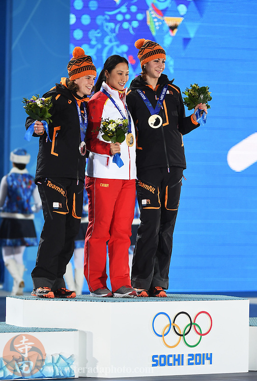 Feb 14, 2014; Sochi, RUSSIA; Margot Boer of the Netherlands (left), Hong Zhang of China (center) and Ireen Wust of the Netherlands (right) pose for photos after receiving their medals during the medal ceremony for Speed Skating Ladies' 1000m at the Sochi 2014 Olympic Winter Games at the Medals Plaza.
