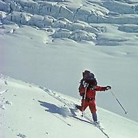 Ski mountaineer Jay Jensen telemarks in knee deep powder below 16,000 foot Warwan Pass during a pioneering two-week ski expedition from Ladakh to Kashmir across India's Great Himalaya Range.