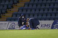 Football - 2020 / 2021 Sky Bet League One - Gillingham vs Accrington Stanley - Priestfield Stadium<br /> <br /> Dominic Samuel (Gillingham FC), receives treatment on the pitch before being carried off on a stretcher  <br /> <br /> <br /> COLORSPORT/DANIEL BEARHAM
