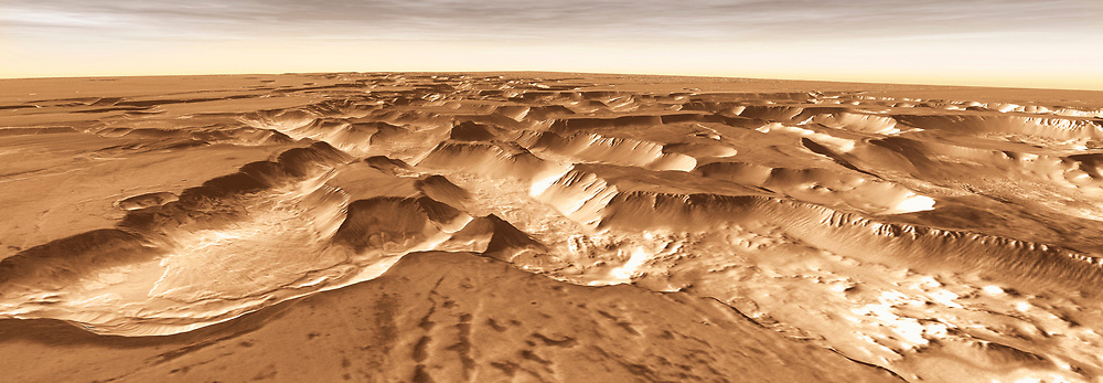 West of Valles Marineris lies a checkerboard named Noctis Labyrinthus, which formed when the Martian crust stretched and fractured. As faults opened, they released subsurface ice and water, causing the ground to collapse.