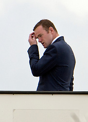 © London News Pictures. 06/06/2012. Luton, UK.  England and Manchester United striker Wayne Rooney with the England football squad boarding a plane at Luton Airport in Bedfordshire on June 6, 2012 to head to Poland for the Euro 2012 football tournament. The squads training camp is based in Krakow.  Photo credit: Ben Cawthra/LNP