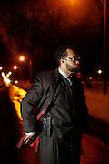 Nazir Al-Mujaahid with his gun Thursday, Jan. 9, 2014 in Milwaukee. (Brian Cassella/Chicago Tribune) B583456289Z.1 <br /> ....OUTSIDE TRIBUNE CO.- NO MAGS,  NO SALES, NO INTERNET, NO TV, CHICAGO OUT, NO DIGITAL MANIPULATION...