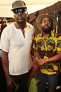September 6, 2012- New York, New York: (L-R) Photographer/Filmmaker Andrew Dosunmu and Stylist Mobolagi Dawdo backstage at the 2012 Mercedes-Benz Fashion Week for The ARISE Magazine Icons Fashion Showcase featuring the designs of Ozwald Boateng, Tiffany Amber, Tsemaye Binitie, Maki Oh and Gavin Rajah held at Lincoln Center on September 6, 2012 in New York City. ARISE is Africa's first and foremost international style magazine. Highlighting African achievement in fashion, music, culture and politics, it provides a positive portrayal of the continent and its contribution to contemporary society across the world. (Terrence Jennings)