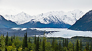 Matanuska Glacier (in 2006), source of the Matanuska River in Alaska, is the largest glacier accessible by car in the United States: 27 miles (43 km) long by 4 miles (6.4 km) wide. It flows near the Glenn Highway in the Chugach Mountains about 100 miles (160 km) northeast of Anchorage. Matanuska Glacier flows about 1 foot (30 cm) per day. Due to ablation of the lower glacier, as of 2007, the location of the glacier terminus has changed little over the previous three decades. Panorama stitched from 2 overlapping photos.