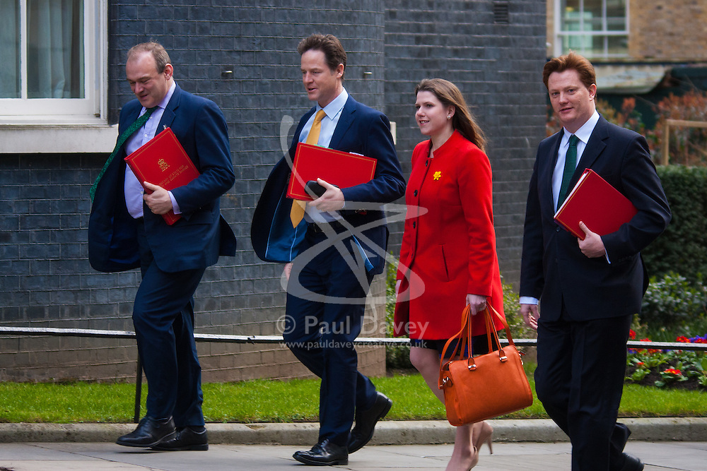 London, March 24th 2015. Members of the Cabinet gather at Downing street for their weekly meeting. PICTURED: Liberal Democrat cabinet members Secretary of State for Energy and Climate Change Ed Davey, Deputy Prime Minister Nick Clegg, Under Secretary of State for Employment relations, consumer and postal affairs Jo Swinton and Chief Secretary to the Treasury Danny Alexander arrive together at 10 Downing Street.