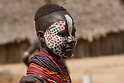 Karo tribe female with painted face. Omo Valley, Ethiopia