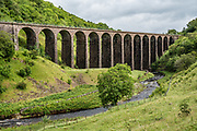 Smardale Gill Viaduct, built 1861, was closed in 1962 as the Barrow steelworks closed, and was restored in 1990 as a cultural icon. Yorkshire Dales National Park, England, United Kingdom, Europe. England Coast to Coast hike with Wilderness Travel, day 7 of 14: Smardale Gill Viaduct (built 1861) and Smardale Gill National Nature Reserve. Visit Kirkby Stephen Parish Church (built in 1240, partly rebuilt in 1847 and restored in the 1870s). Overnight 2 of 2 in Brownber Hall Country House, Cumbria county. [This image, commissioned by Wilderness Travel, is not available to any other agency providing group travel in the UK, but may otherwise be licensable from Tom Dempsey – please inquire at PhotoSeek.com.]