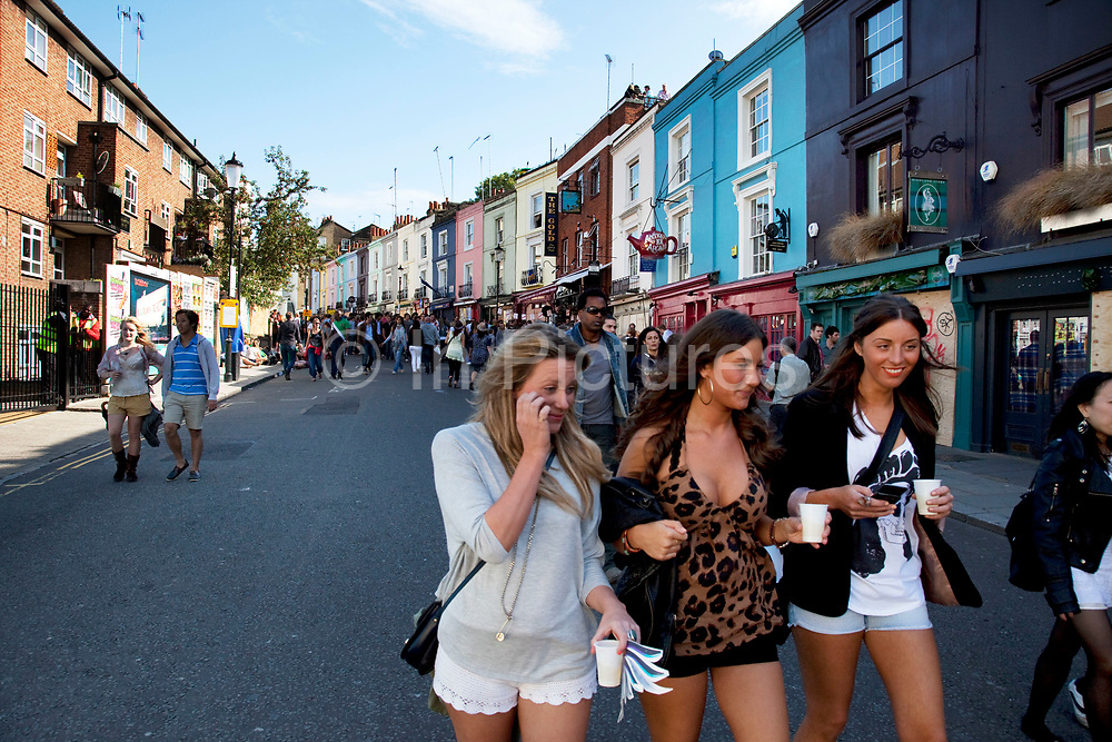 Girls walking down Portobello Road towards Notting Hill Carnival in West London. The Notting Hill Carnival is an annual event which since 1964 has taken place each August, over two days (the August bank holiday Monday and the day beforehand). It is led by members of the West Indian / Caribbrean community, particularly the Trinidadian and Tobagonian British population, many of whom have lived in the area since the 1950s. The carnival has attracted up to 2 million people in the past, making it the second largest street festival in the world. The celebration centres around a parade of floats, dancers and sound systems.