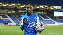 Siriki Dembele of Peterborough United celebrates at full-time with the match ball after scoring a hat-trick - Mandatory by-line: Joe Dent/JMP - 31/10/2020 - FOOTBALL - Weston Homes Stadium - Peterborough, England - Peterborough United v Shrewsbury Town - Sky Bet League One
