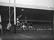 The Down goalie jumps to hit the ball wide during the All Ireland Senior Gaelic Football Final Kerry v Down in Croke Park on the 22nd September 1960. Down 2-10 Kerry 0-8.