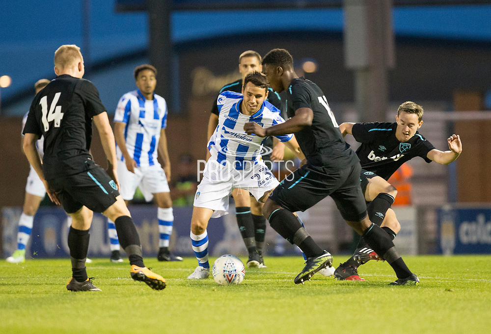 Tommy O'Sullivan battles for possession during the Pre-Season Friendly match between Colchester United and West Ham United at the Weston Homes Community Stadium, Colchester, England on 18 July 2017. Photo by Phil Chaplin.