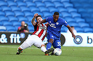 Kieron Freeman of Sheffield United (l) fouls Junior Hoilett of Cardiff city (r).EFL Skybet championship match, Cardiff city v Sheffield Utd at the Cardiff City Stadium in Cardiff, South Wales on Tuesday 15th August 2017.<br /> pic by Andrew Orchard, Andrew Orchard sports photography.