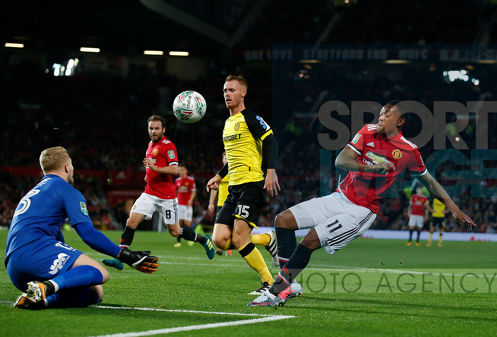 Connor Ripley of Burton Albion saves from Anthony Martial of Manchester United during the Carabao Cup Third Round match at the Old Trafford Stadium, Manchester. Picture date 20th September 2017. Picture credit should read: Simon Bellis/Sportimage