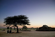 As the sun rises, two men perform their morning prayers beneath a tree in the village of Dar es Salaam in central Chad. Hungry Planet: What the World Eats (p. 73).