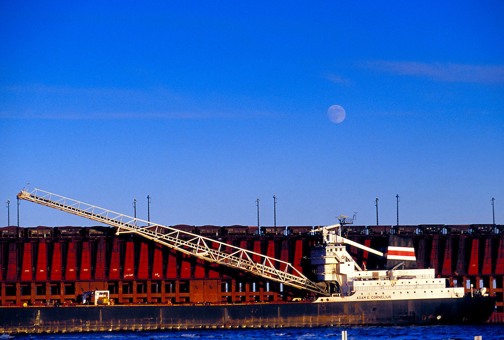 THE FREIGHTER ADAM E. CORNELIUS  DOCKED AT THE LAKE SUPERIOR & ISHPEMING RAILROAD IRON ORE DOCK IN MARQUETTE MICHIGAN WITH MOON RISE.