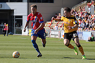 Dagenham's Matt Partridge battles for the ball against Newport's Miles Storey. Skybet football league two match , Newport county v Dagenham & Redbridge at Rodney Parade in Newport, South Wales on Saturday 18th April 2015.<br /> pic by David Richards, Andrew Orchard sports photography.