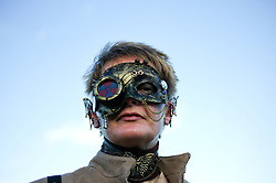 © Licensed to London News Pictures. <br /> 01/11/2014. <br /> <br /> Whitby, Yorkshire, United Kingdom<br /> <br /> Janet Ross from Birtley comes dressed as a Steampunk to the Whitby Goth Weekend. <br /> <br /> The event this weekend brings together thousands of extravagantly dressed followers of Victoriana, Steampunk, Cybergoth and Romanticism who all visit the town to take part in celebrating Gothic culture. This weekend marks the 20th anniversary since the event was started by local woman Jo Hampshire.<br /> <br /> Photo credit : Ian Forsyth/LNP