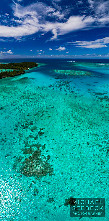 Beautiful aqua colours of an inshore lagoon surrounding the Isle of Pines, New Caledonia.<br /> <br /> Open Edition print