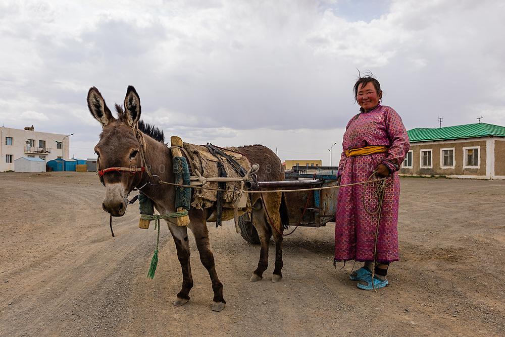 A woman and her donkey, Bayandalay, Mongolia. Photo © Robert van Sluis