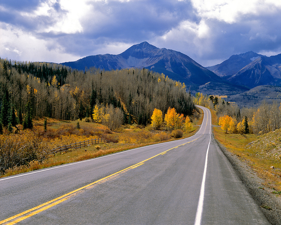 A Colorado mountain highway in autumn beckons travelers.
