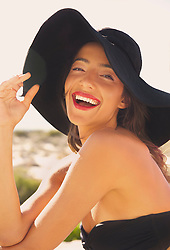 Smiling Young Woman Wearing Wide Brim Hat