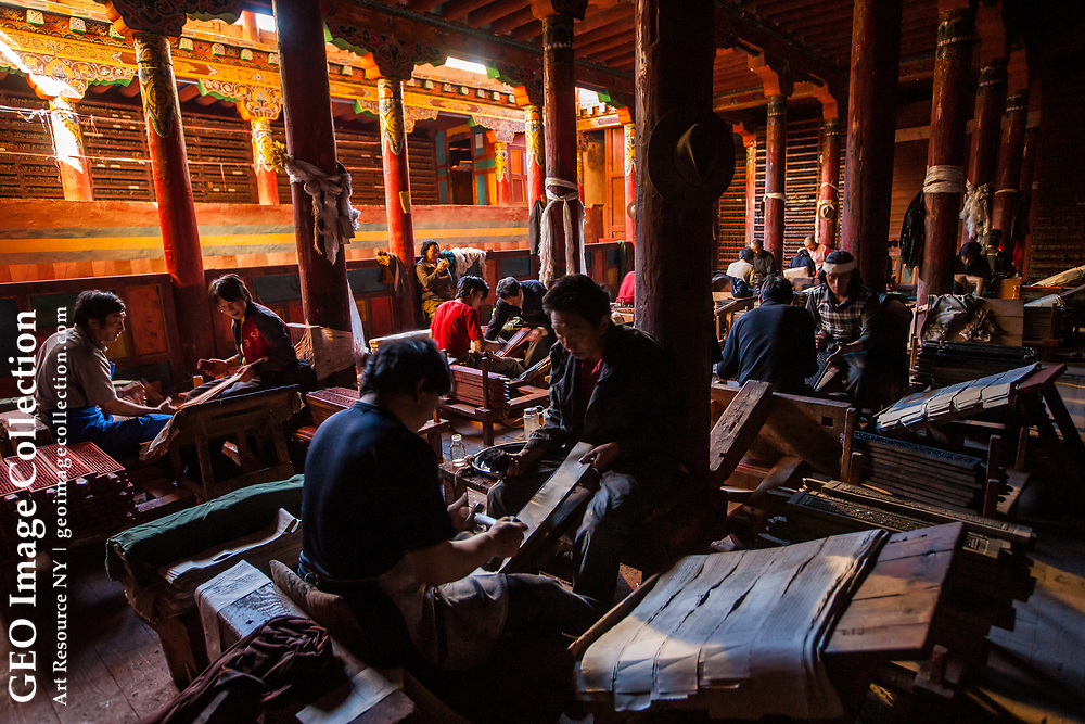 At the Dege Parkhang books are made in the same way as they have been for almost 300 years, from blocks that are hand carved and inked, then printed into long strips, dried and bound into volumes. Sichuan, China