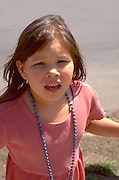 Surprised girl age 5. In the Heart of the Beast May Day Festival and Parade Minneapolis  Minnesota USA