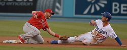 June 28, 2017 - Los Angeles, California, U.S. - Los Angeles Angels second baseman Cliff Pennington tags out Los Angeles Dodgers' Cody Bellinger (35) at second base in the second inning of a Major League baseball game at Dodger Stadium on Tuesday, June 27, 2017 in Los Angeles. (Photo by Keith Birmingham, Pasadena Star-News/SCNG) (Credit Image: © San Gabriel Valley Tribune via ZUMA Wire)