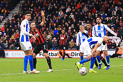 Bournemouth's Marc Pugh (centre) claims for hand-ball against Brighton & Hove Albion's Bruno Saltor (right)during the Emirates FA Cup, third round match at the Vitality Stadium, Bournemouth.