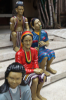 Baguio's Igorot Stairs are found right outside Barrio Fiesta, a famous restaurat specializing in local foods. The statues are mad of wood, even though they don't look like it as they have been painted over and varnished into a shiny platic-like sheen. The statues and wood sculptures depict the life of the Igorot tribe, the native inhabitants of Baguio. Today not all of the sculpture on the steps are those of Igorots - there are also those of famous Philippine political figures, such as past presidents, there are also sculpture of sleeping guards and some animals.   The balance found in the sculptures can be seen obviously in the way that each sculpture has complete body parts.