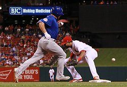 September 28, 2017 - St Louis, MO, USA - St. Louis Cardinals first baseman Jose Martinez is unable to catch the throw from pitcher Matt Bowman as the Chicago Cubs' Kyle Schwarber reaches safely, then advances to second on the error, in the 11th inning on Thursday, Sept. 28, 2017, at Busch Stadium in St. Louis. The Cubs won, 2-1, as Schwarber scored the go-ahead run. (Credit Image: © Chris Lee/TNS via ZUMA Wire)