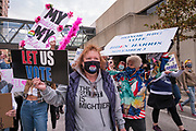 17 OCTOBER 2020 - DES MOINES, IOWA: People walk past the federal building in downtown Des Moines during the We Dissent Women's March. About 300 women participated in the We Dissent Women's March in Des Moines. The march was one of several held across the US to protest the confirmation of Amy Coney Barrett to the Supreme Court seat once held by Ruth Bader Ginsburg. The women marched through downtown and passed by the closed offices of US Senators Chuck Grassley and Joni Ernst.         PHOTO BY JACK KURTZ