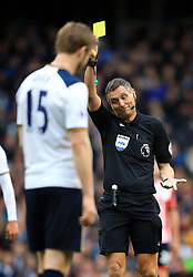 19 March 2017 - Premier League - Tottenham Hotspur v Southampton - Referee Andre Marriner shows a yellow card - Photo: Marc Atkins / Offside.