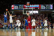 DALLAS, TX - FEBRUARY 01: Michael Dixon Jr. #11 of the Memphis Tigers shoots the ball over Nick Russell #12 of the SMU Mustangs on February 1, 2014 at Moody Coliseum in Dallas, Texas.  (Photo by Cooper Neill/Getty Images) *** Local Caption *** Michael Dixon Jr.
