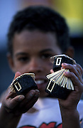 A boy sells little houses made with lava rock from Fogo's volcano. The most recent eruption of this volcano  was in 1995.