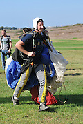 Israel, Habonim Skydive centre, Parachutist after touchdown collecting his equipment
