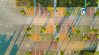 Aerial view of a colorful parking lot during the morning, Púbol, Spain.