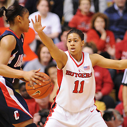 Mar 2, 2009; Piscataway, NJ, USA; Rutgers guard Nikki Speed (11) defends Connecticut forward Maya Moore (23) during the first half of Rutgers game against nationally rated #1 Connecticut at the Louis Brown Athletic Center. Connecticut won 69-59 to finish their regular season a perfect 30-0.