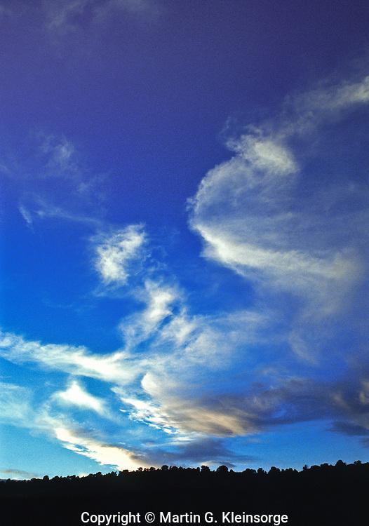 Cirrus fibratus clouds over the Colorado plains.