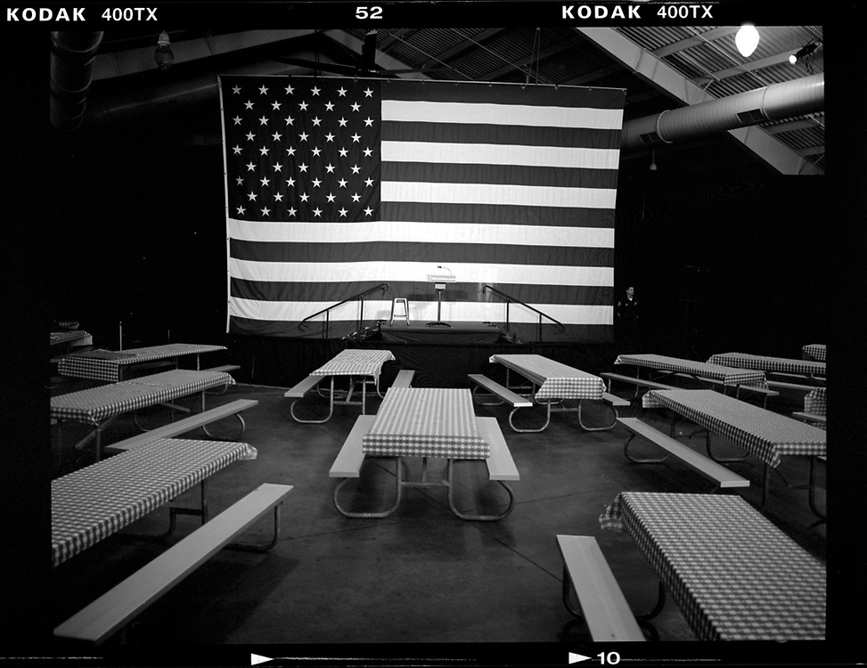 A police officer rovides security in a room full of picnic tables at a campaign event for Democratic presidential candidate Hillary Clinton in Des Moines, Iowa. © Photo by Jim Young