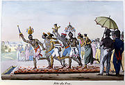 Festival of Fire. Men and a woman walking on hot embers observed by Eruopeans. Lithograph from L'Inde Francaise, 1828