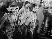 Naga Sadhus (Holy men) enroute to bathe in the confluence of sacred rivers at the Kumbh Mela festival, Prayagraj, India.